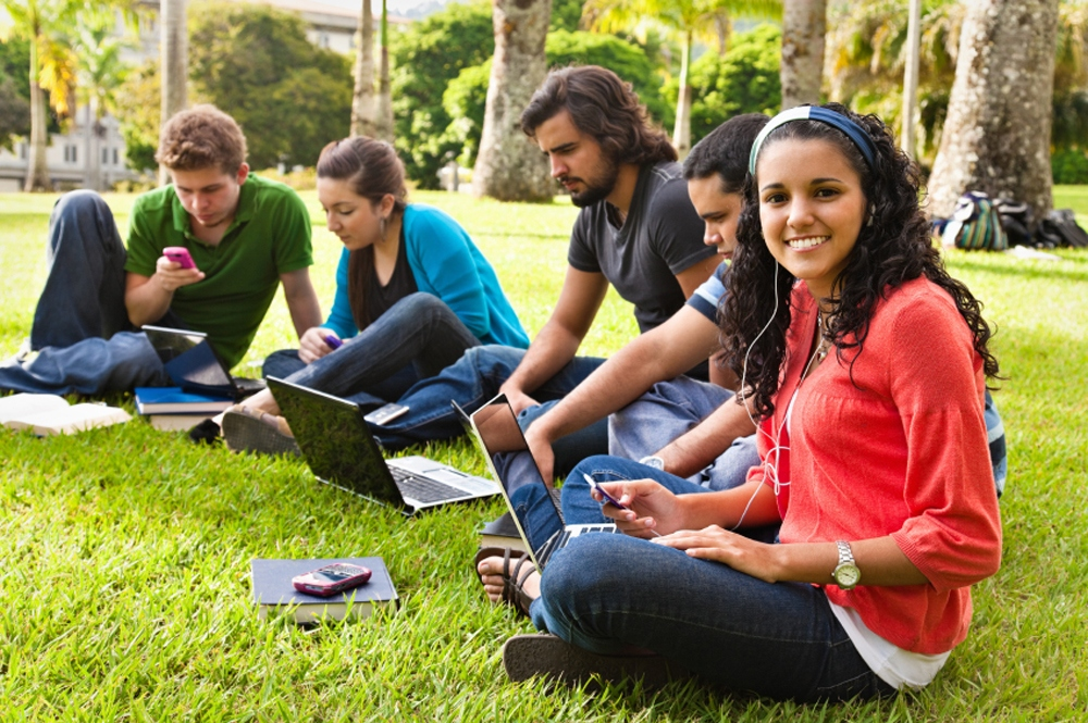 Students studying in a lawn